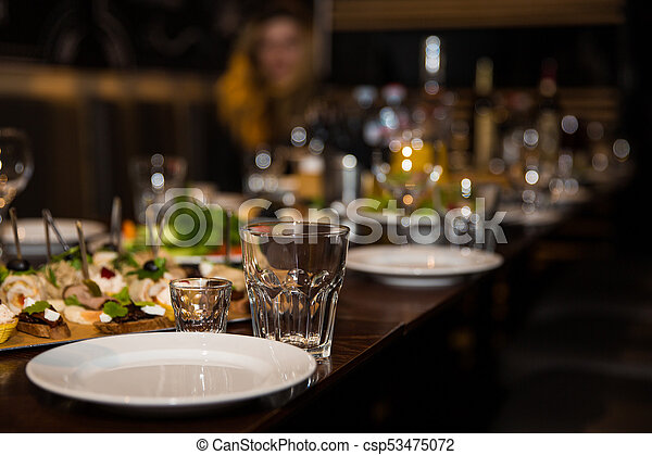 Table setting decor with cutlery, plates and glasses on reception background - csp53475072