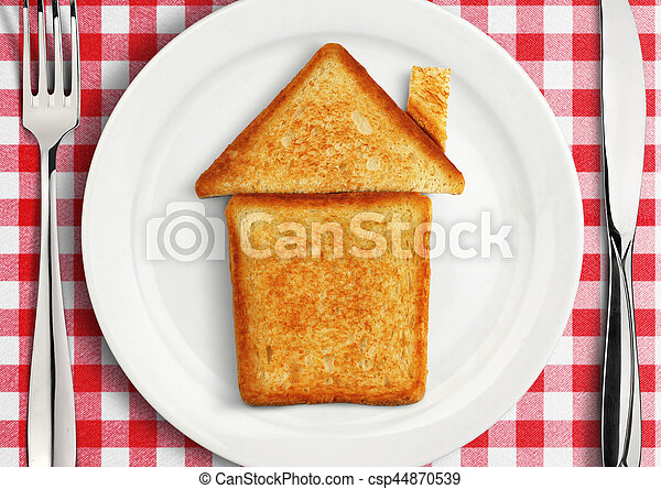 Table setting with house on plate, concept - csp44870539