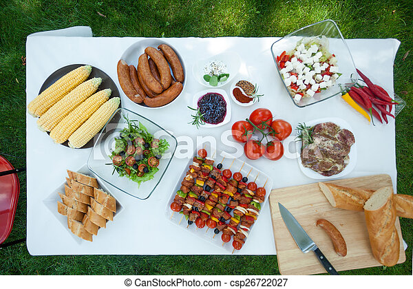 Table with delicious meals - csp26722027