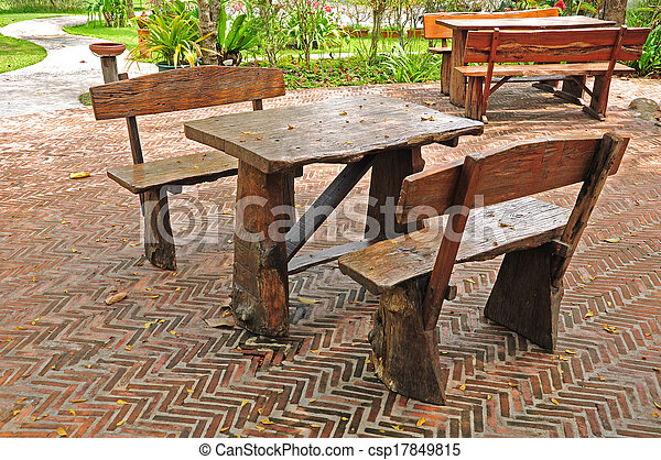 Tables and chairs on brick patio - csp17849815