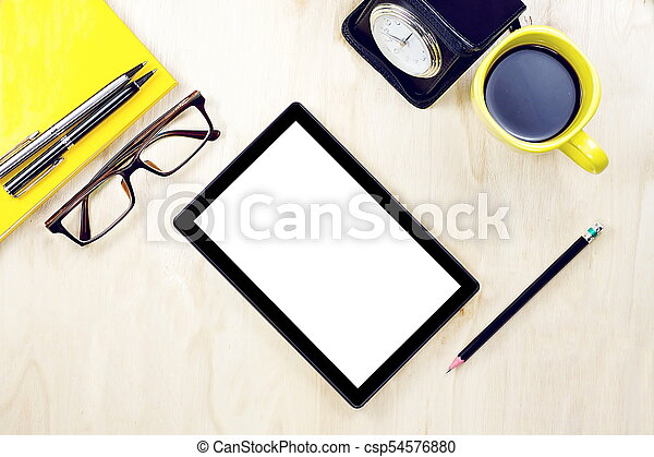 Tablet PC with blank white screen display and eyeglasses, cup of coffee and office supply on the wooden working table for business and education concepts. - csp54576880