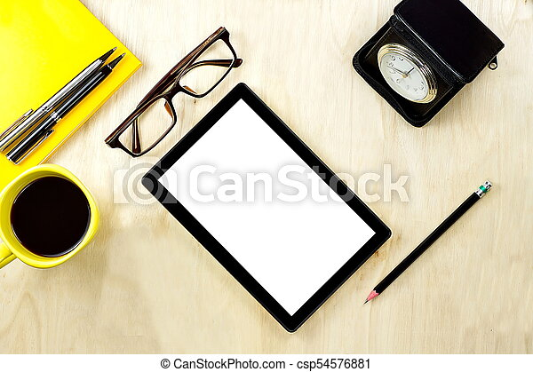 Tablet PC with blank white screen display and eyeglasses, cup of coffee and office supply on the wooden working table for business and education concepts. - csp54576881