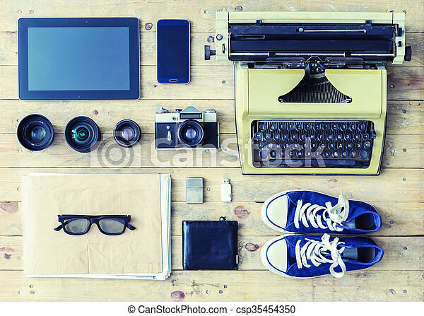Tablet, phone, camera, lenses, album, glasses and different objects - csp35454350