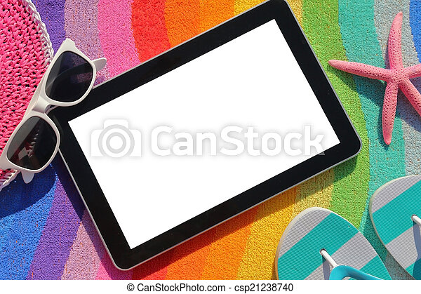 Tablet with blank screen on beach towel with accessories   - csp21238740