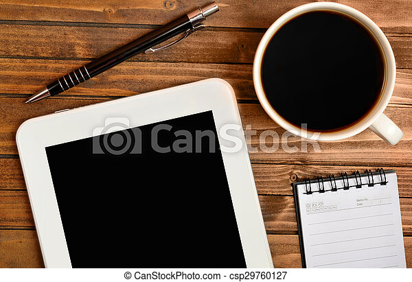 Tablet with coffee cup and notepad - csp29760127
