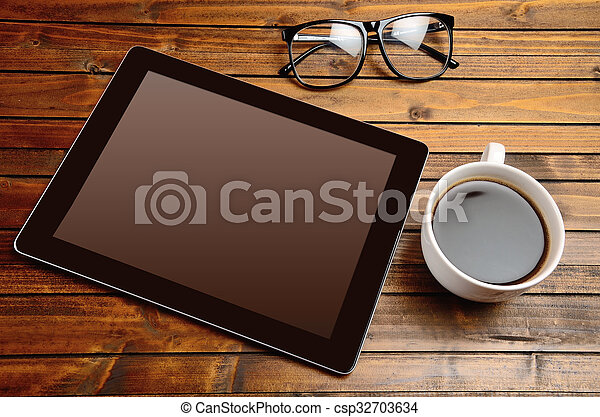 Tablet with coffee cup - csp32703634