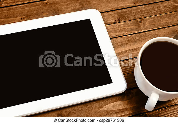 Tablet with cup of coffee - csp29761306