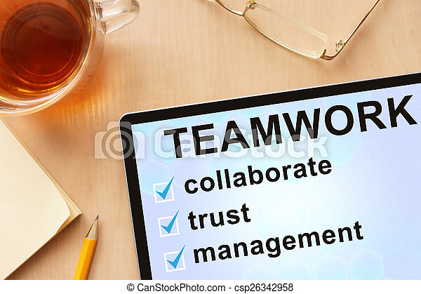 Tablet with word teamwork. - csp26342958