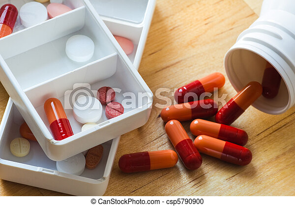 Tablets, capsules and pills in pillbox as daily medication - csp5790900
