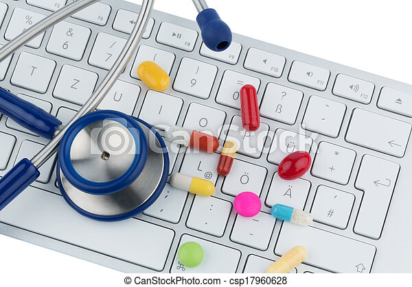 tablets on keyboard - csp17960628
