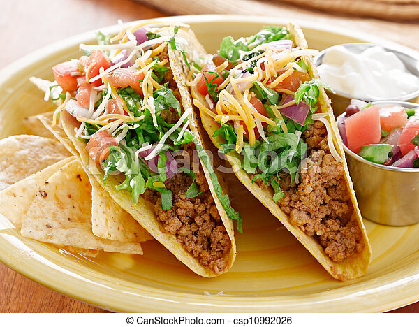Tacos on a platter with tortillas - mexican food - csp10992026
