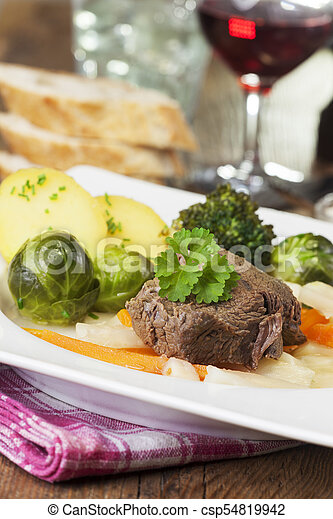 tafelspitz meat on a plate with vegetables - csp54819942