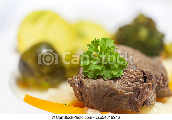 tafelspitz meat on a plate with vegetables - csp54819946