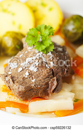 tafelspitz meat on a plate with vegetables - csp59226132