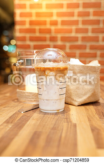 Take away Latte with Brick background on the wood table - csp71204859