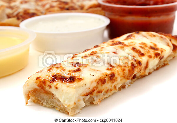 Take cheese pizza sticks with a container of marinara sauce, ranch dressing and garlic butter. Focus on pizza stick in front. Shot with the Canon 20D. - csp0041024
