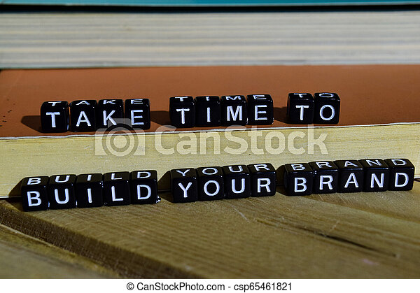 Take time to build your brand on wooden blocks. - csp65461821
