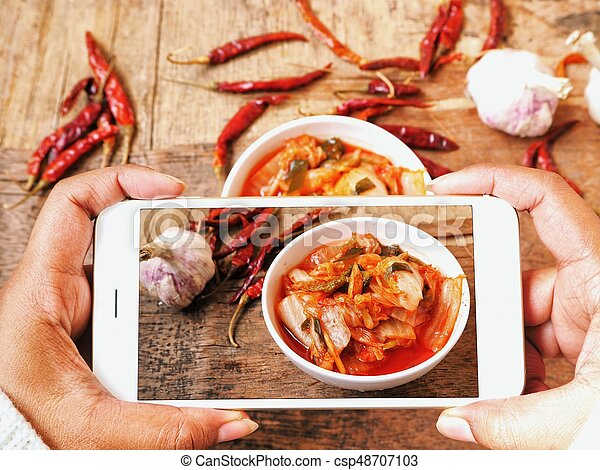 Taking A Photo Of Kimchi With Smart Phone