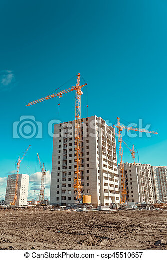 Tall cranes and modern buildings under construction - csp45510657