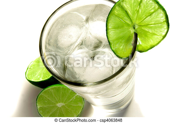 Tall glass of ice water with a slice of lime - csp4063848
