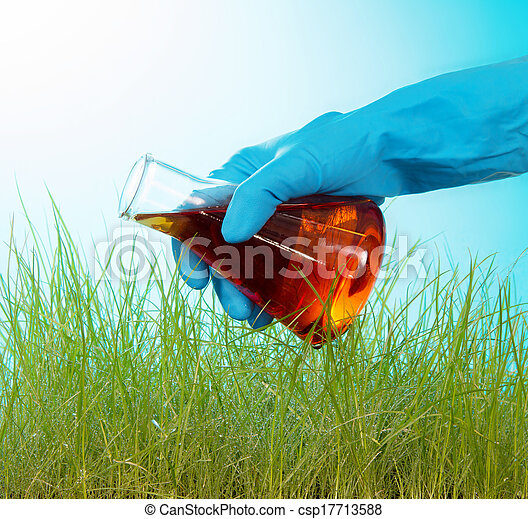 Tall grass green watered red liquid - csp17713588