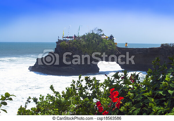Tanah Lot and Hibiscus Flowers. - csp18563586