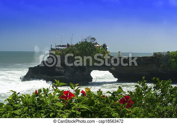 Tanah Lot and Hibiscus. - csp18563472