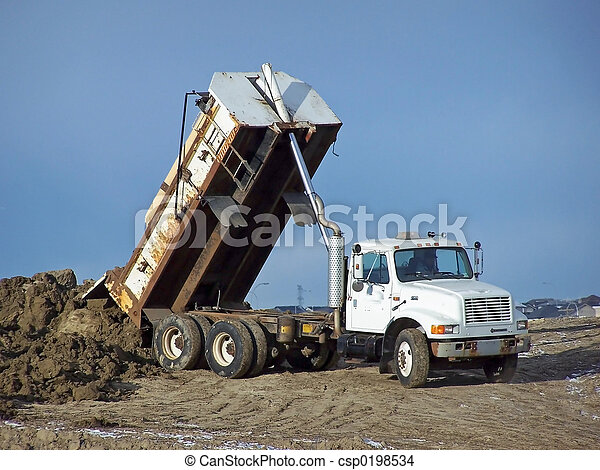 Tandem Dump Truck A Unloading Some Dirt At Construction Site