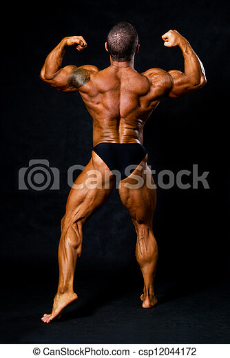 Tanned Bodybuilder Shows Muscles Of Arms And Back In Black