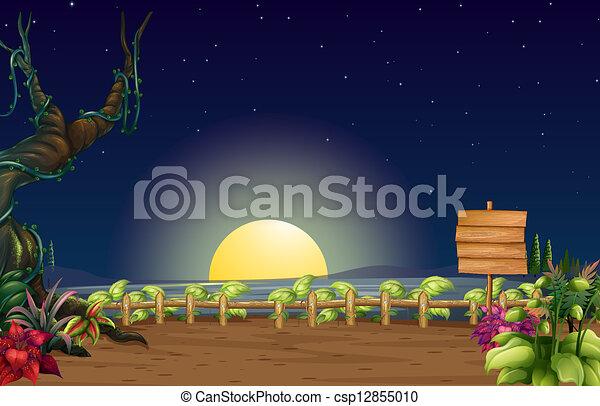 Una vista nocturna y el letrero vacío - csp12855010