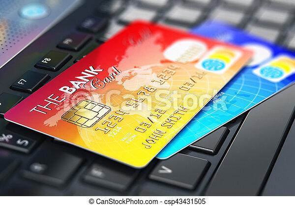 Tarjetas de crédito en el teclado portátil - csp43431505