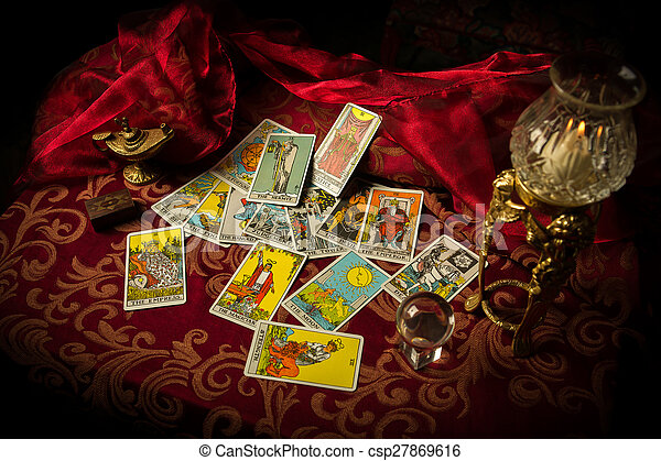 Tarot Cards Spread and scattered on Table Haphazardly - csp27869616