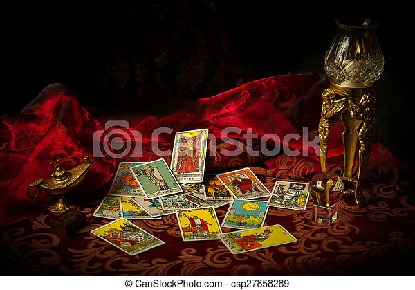 Tarot Cards Spread and scattered on Table Haphazardly - csp27858289