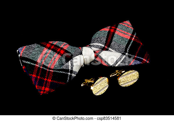 Tartan Bow Tie and Cuff Links on a Black Background - csp83514581