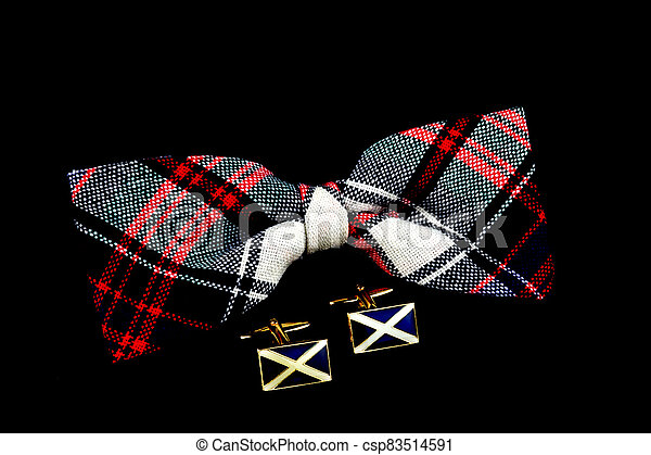 Tartan Bow Tie and Scottish Flag Cuff Links on a Black Background - csp83514591