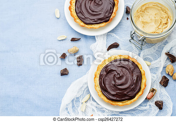 tartlets with peanut butter mousse and chocolate - csp26427272
