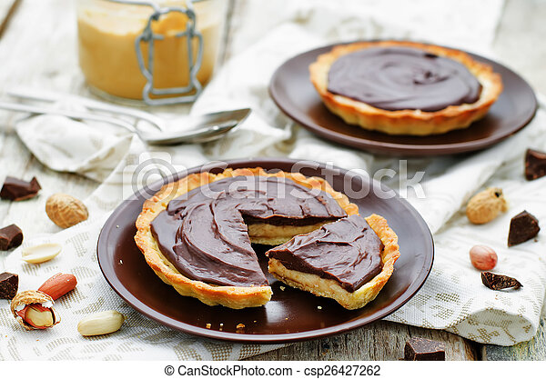tartlets with peanut butter mousse and chocolate - csp26427262