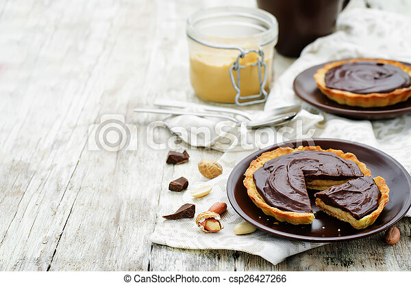 tartlets with peanut butter mousse and chocolate - csp26427266