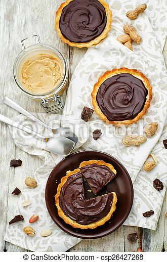 tartlets with peanut butter mousse and chocolate - csp26427268