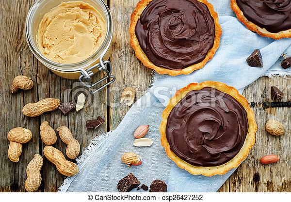 tartlets with peanut butter mousse and chocolate - csp26427252