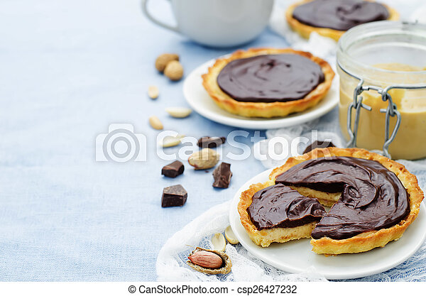 tartlets with peanut butter mousse and chocolate - csp26427232
