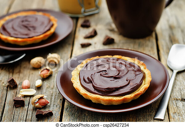 tartlets with peanut butter mousse and chocolate - csp26427234