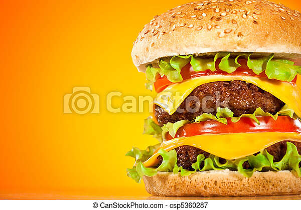 Tasty and appetizing hamburger on a yellow - csp5360287