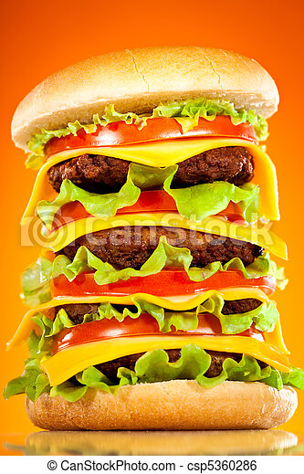 Tasty and appetizing hamburger on a yellow - csp5360286