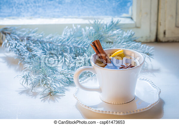 Tasty and sweet tea with cinnamon and orange for Christmas - csp61473653