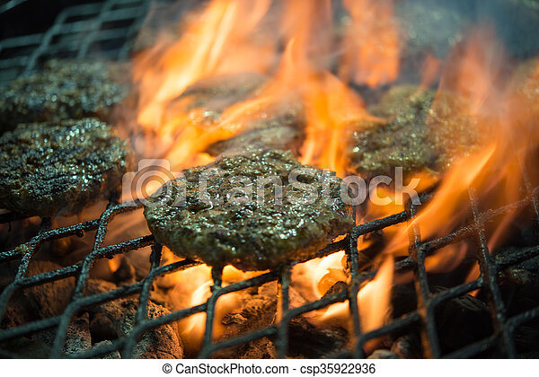 tasty beef burgers on the grill - csp35922936
