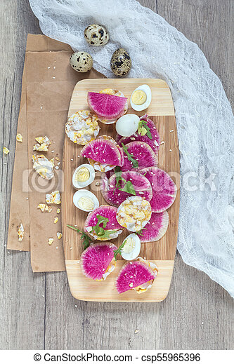 Tasty nutritious grain breads with red radish. - csp55965396