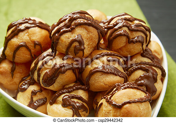 Tasty Pastries with Chocolate Sauce on a Plate - csp29442342