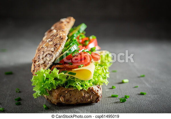Tasty sandwich with cheese, ham and cucumber for breakfast - csp61495019