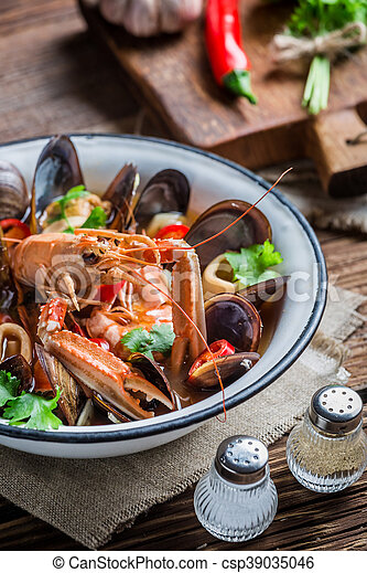 Tasty seafood soup with langoustines and mussels - csp39035046